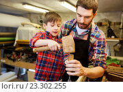 Купить «father and son with chisel working at workshop», фото № 23302255, снято 14 мая 2016 г. (c) Syda Productions / Фотобанк Лори