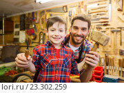 Купить «boy with dad holding chisel and hammer at workshop», фото № 23302259, снято 14 мая 2016 г. (c) Syda Productions / Фотобанк Лори