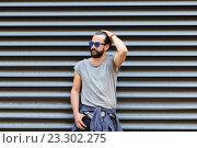 Купить «happy smiling man with beard on city street», фото № 23302275, снято 2 июня 2016 г. (c) Syda Productions / Фотобанк Лори