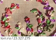 Купить «Рукоделие. Вышивка атласными лентами. Фрагмент круглого цветочного орнамента», фото № 23327275, снято 29 июля 2016 г. (c) Виктория Катьянова / Фотобанк Лори
