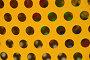 Текстура. Рельефная металлическая поверхность желтого цвета с блестками и круглыми симметричными отверстиями, эксклюзивное фото № 23327923, снято 26 июля 2016 г. (c) lana1501 / Фотобанк Лори