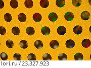 Купить «Текстура. Рельефная металлическая поверхность желтого цвета с блестками и круглыми симметричными отверстиями», эксклюзивное фото № 23327923, снято 26 июля 2016 г. (c) lana1501 / Фотобанк Лори