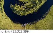 Купить «Изгиб реки в болотистой местности, деревянные мостки и пирс с лодками. Карелия», фото № 23328599, снято 17 июля 2016 г. (c) Кекяляйнен Андрей / Фотобанк Лори
