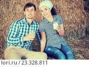 Купить «man and woman in hay with milk», фото № 23328811, снято 21 февраля 2019 г. (c) Яков Филимонов / Фотобанк Лори