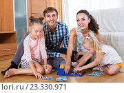 Купить «Parents and daughters with toy lotto», фото № 23330971, снято 17 февраля 2019 г. (c) Яков Филимонов / Фотобанк Лори