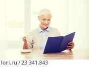 Купить «happy smiling senior woman reading book at home», фото № 23341843, снято 10 июля 2015 г. (c) Syda Productions / Фотобанк Лори
