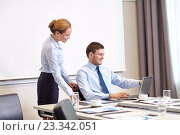 Купить «businessman and secretary with laptop in office», фото № 23342051, снято 25 октября 2014 г. (c) Syda Productions / Фотобанк Лори