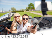 Купить «happy couple in car taking selfie with smartphone», фото № 23342515, снято 15 июля 2015 г. (c) Syda Productions / Фотобанк Лори