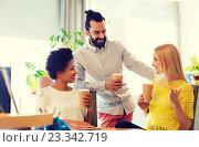 Купить «business team with coffee cups talking at office», фото № 23342719, снято 29 марта 2015 г. (c) Syda Productions / Фотобанк Лори