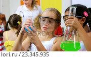 Купить «Kids doing a chemical experiment in laboratory», видеоролик № 23345935, снято 4 апреля 2020 г. (c) Wavebreak Media / Фотобанк Лори