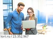 Купить «Business executives looking at laptop», фото № 23352967, снято 19 марта 2016 г. (c) Wavebreak Media / Фотобанк Лори