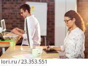 Купить «Businesswoman using graphic tablet», фото № 23353551, снято 19 марта 2016 г. (c) Wavebreak Media / Фотобанк Лори
