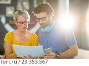 Купить «Business executives looking at document», фото № 23353567, снято 19 марта 2016 г. (c) Wavebreak Media / Фотобанк Лори
