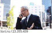 Купить «senior businessman calling on smartphone in city», видеоролик № 23355439, снято 23 июля 2016 г. (c) Syda Productions / Фотобанк Лори