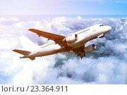 Купить «Самолет в небе среди белых плотных облаков», фото № 23364911, снято 20 мая 2019 г. (c) Зезелина Марина / Фотобанк Лори