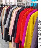 Купить «Разноцветные пальто висят на вешалке», фото № 23368039, снято 8 июня 2016 г. (c) Андрей Радченко / Фотобанк Лори