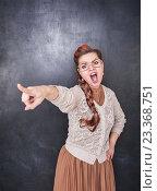 Злая учительница на фоне школьной доски. Стоковое фото, фотограф Darkbird77 / Фотобанк Лори