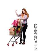 Купить «Woman with shopping cart and bags isolated on white», фото № 23369675, снято 7 июня 2016 г. (c) Elnur / Фотобанк Лори