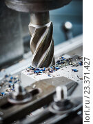 Купить «industrial metalworking cutting process by milling cutter», фото № 23371427, снято 1 марта 2016 г. (c) Дмитрий Калиновский / Фотобанк Лори