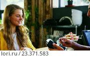 Купить «Customer paying with credit card at counter», видеоролик № 23371583, снято 9 апреля 2020 г. (c) Wavebreak Media / Фотобанк Лори