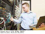Купить «network engineer admin at data center», фото № 23376387, снято 17 января 2016 г. (c) Дмитрий Калиновский / Фотобанк Лори