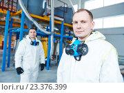 Купить «chemical industry workers at factory», фото № 23376399, снято 27 января 2016 г. (c) Дмитрий Калиновский / Фотобанк Лори