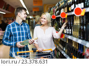 Купить «сouple of customers purchasing at wine section in supermarket», фото № 23378631, снято 15 ноября 2018 г. (c) Яков Филимонов / Фотобанк Лори