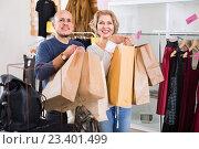 Купить «Cheerful pleasant mature woman and man holding bags», фото № 23401499, снято 22 ноября 2018 г. (c) Яков Филимонов / Фотобанк Лори