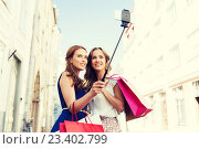 Купить «women shopping and taking selfie by smartphone», фото № 23402799, снято 9 августа 2015 г. (c) Syda Productions / Фотобанк Лори