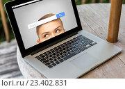 Купить «close up of laptop computer on table at hotel», фото № 23402831, снято 15 февраля 2015 г. (c) Syda Productions / Фотобанк Лори