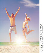 Купить «couple jumping on the beach», фото № 23403251, снято 4 августа 2012 г. (c) Syda Productions / Фотобанк Лори