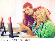 Купить «students with computer studying at school», фото № 23403263, снято 16 июня 2013 г. (c) Syda Productions / Фотобанк Лори