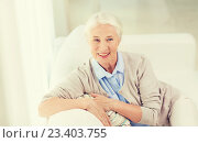 Купить «happy senior woman face at home», фото № 23403755, снято 10 июля 2015 г. (c) Syda Productions / Фотобанк Лори