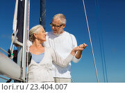 Купить «happy senior couple on sail boat or yacht in sea», фото № 23404007, снято 18 августа 2015 г. (c) Syda Productions / Фотобанк Лори