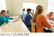 Купить «group of students with notebooks at school lesson», фото № 23404043, снято 22 апреля 2016 г. (c) Syda Productions / Фотобанк Лори