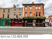Купить «building with bar or pub on street of Dublin city», фото № 23404359, снято 21 июня 2016 г. (c) Syda Productions / Фотобанк Лори