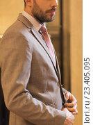 Купить «close up of man trying suit at clothing store», фото № 23405095, снято 1 апреля 2016 г. (c) Syda Productions / Фотобанк Лори