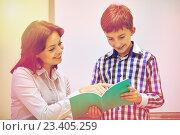 Купить «school boy with notebook and teacher in classroom», фото № 23405259, снято 15 ноября 2014 г. (c) Syda Productions / Фотобанк Лори