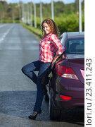 Купить «Девушка в красной рубашке и в каблуках на шпильках позирует около автомобиля», фото № 23411243, снято 12 августа 2016 г. (c) Кекяляйнен Андрей / Фотобанк Лори