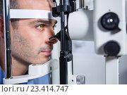 Купить «Male patient getting his cornea checked with slit lamp», фото № 23414747, снято 19 июня 2016 г. (c) Wavebreak Media / Фотобанк Лори