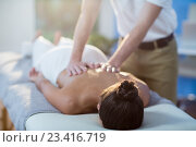 Купить «Male physiotherapist giving back massage to female patient», фото № 23416719, снято 1 июня 2016 г. (c) Wavebreak Media / Фотобанк Лори