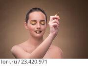 Купить «Woman with golden pen in fashion concept», фото № 23420971, снято 19 июля 2016 г. (c) Elnur / Фотобанк Лори