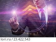 Businessman pressing virtual buttons in business concept. Стоковое фото, фотограф Elnur / Фотобанк Лори
