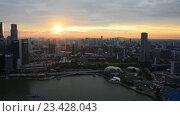 Купить «Восход солнца над азиатским мегаполисом», видеоролик № 23428043, снято 24 октября 2014 г. (c) Elnur / Фотобанк Лори