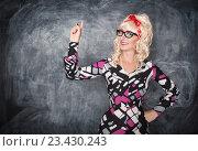 Учительница указывает на что-то пальцем. Стоковое фото, фотограф Darkbird77 / Фотобанк Лори