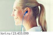 Купить «close up of happy woman in earphones at home», фото № 23433099, снято 13 августа 2015 г. (c) Syda Productions / Фотобанк Лори