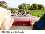 Купить «happy friends pushing broken cabriolet car», фото № 23433227, снято 28 мая 2016 г. (c) Syda Productions / Фотобанк Лори