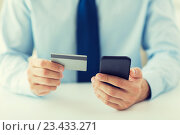 Купить «close up of hands with smart phone and credit card», фото № 23433271, снято 13 августа 2015 г. (c) Syda Productions / Фотобанк Лори