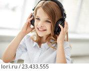 Купить «smiling little girl with headphones at home», фото № 23433555, снято 31 июля 2013 г. (c) Syda Productions / Фотобанк Лори