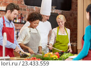 Купить «happy friends and chef cook cooking in kitchen», фото № 23433559, снято 12 февраля 2015 г. (c) Syda Productions / Фотобанк Лори